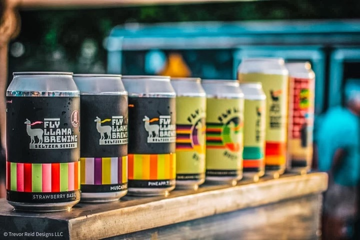 Sign up to be a vendor at Llamapalooza - Beer lined up on a shelf